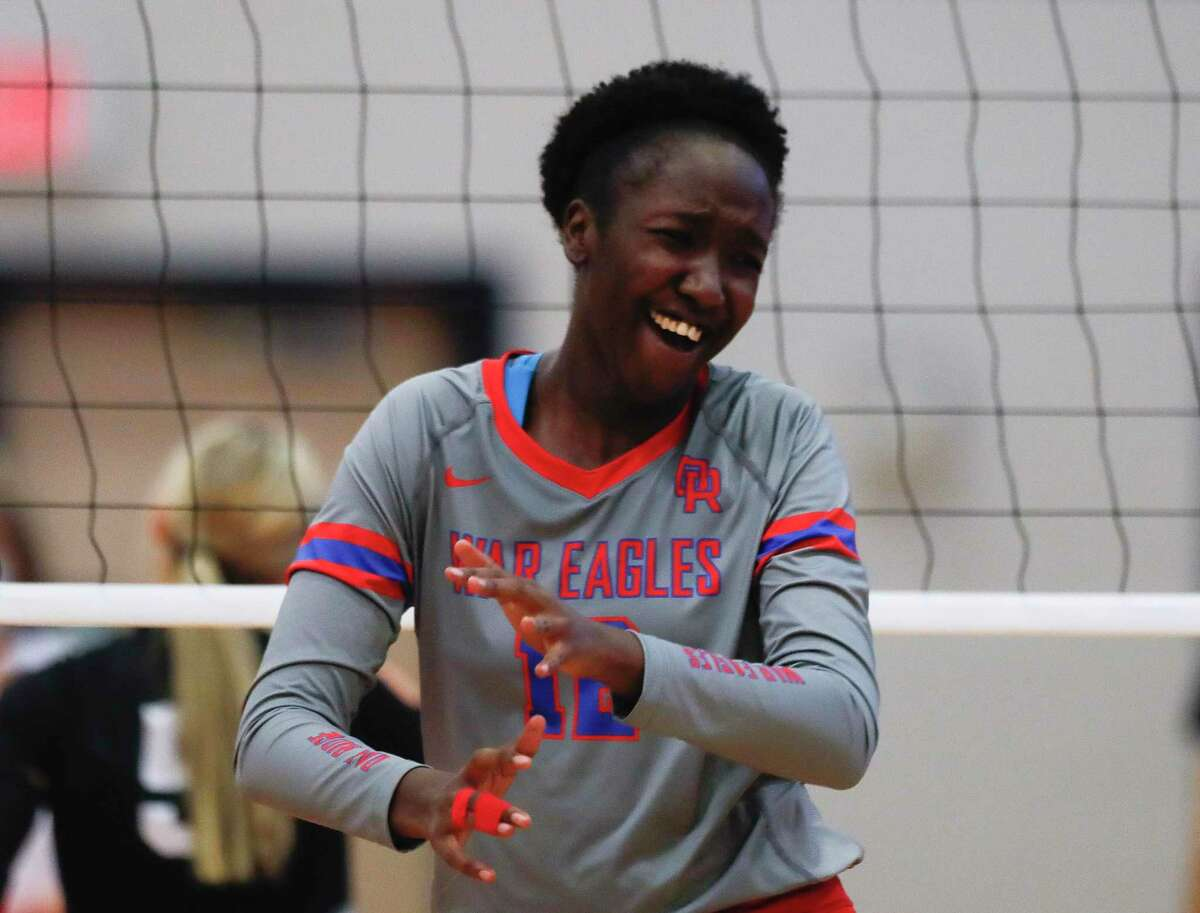 Oak Ridge's Samiah Howard (12) reacts after scoring a point in the first set during a non-district high school volleyball match at Oak Ridge High School, Tuesday, Aug. 17, 2021.