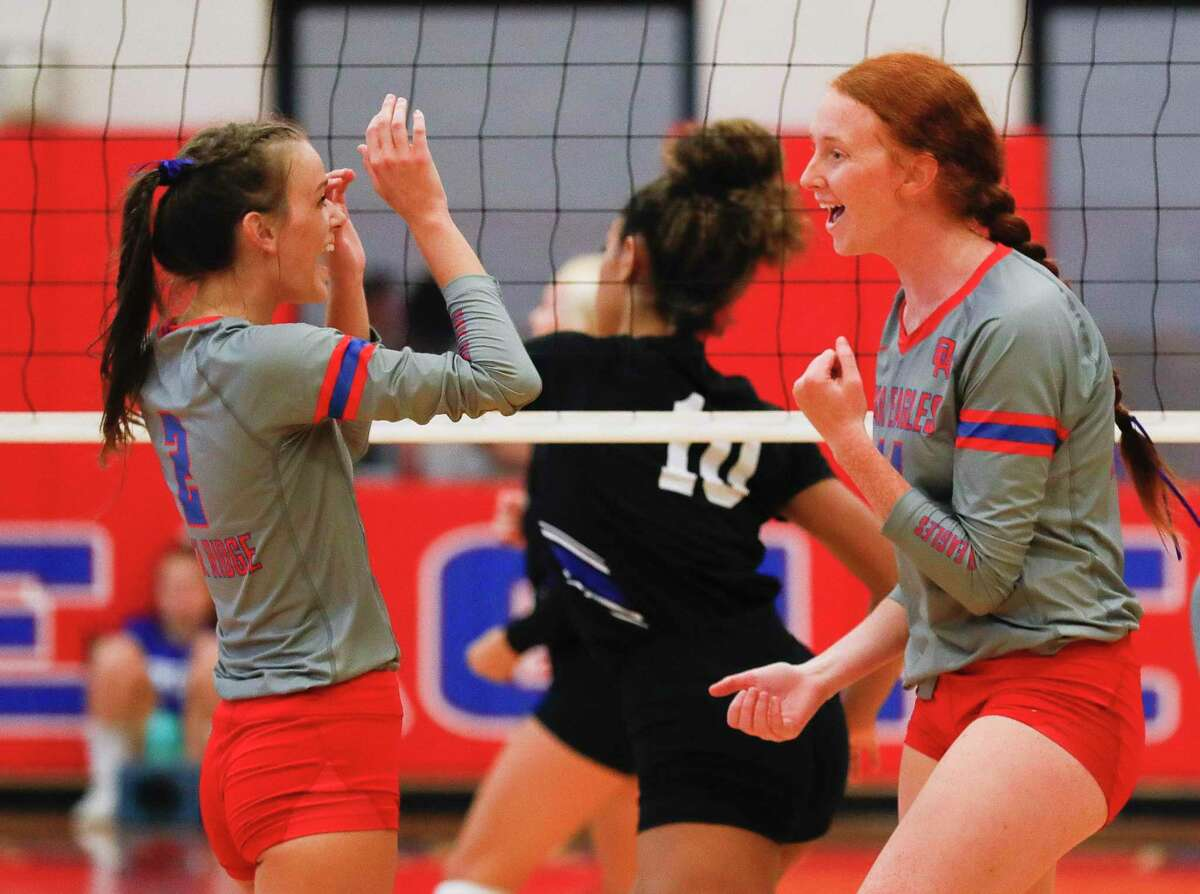 Oak Ridge's Ellie Davis (14) celebrates after scoring a point beside Avery Fowler (2) in the first set during a non-district high school volleyball match at Oak Ridge High School, Tuesday, Aug. 17, 2021.