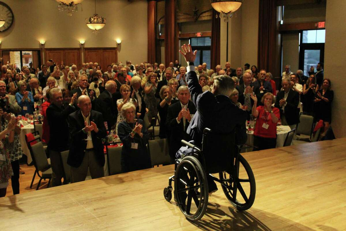 """Gov. Greg Abbott waves to an unmasked crowd during a Republican event in Collin County on Monday night, Aug. 16, 2021. Abbott posted the photo on Twitter as COVID-19 hospitalizations in Texas hit their highest peak since January: """"Another standing room only event in Collin County tonight,"""" Abbott wrote. """"Thank y'all for the enthusiastic reception. Let's keep this energy up and send a message that Texas values are NOT up for grabs in 2022."""""""