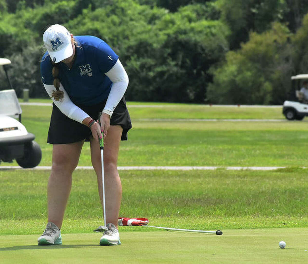 Marquette Catholic's Gracie Piar sinks a birdie on hole No. 3 at Legacy Golf Course at the Madison County Tournament on Tuesday in Granite City.