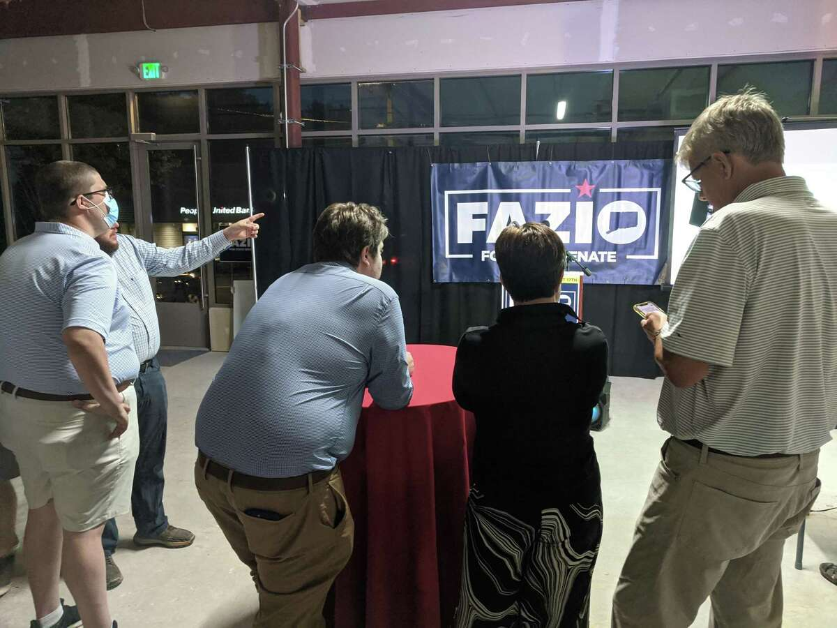 Republicans await the results of the voting in the race for the 36th Senate District, at the GOP headquarters for candidate Ryan Fazio on Tuesday night in Greenwich.