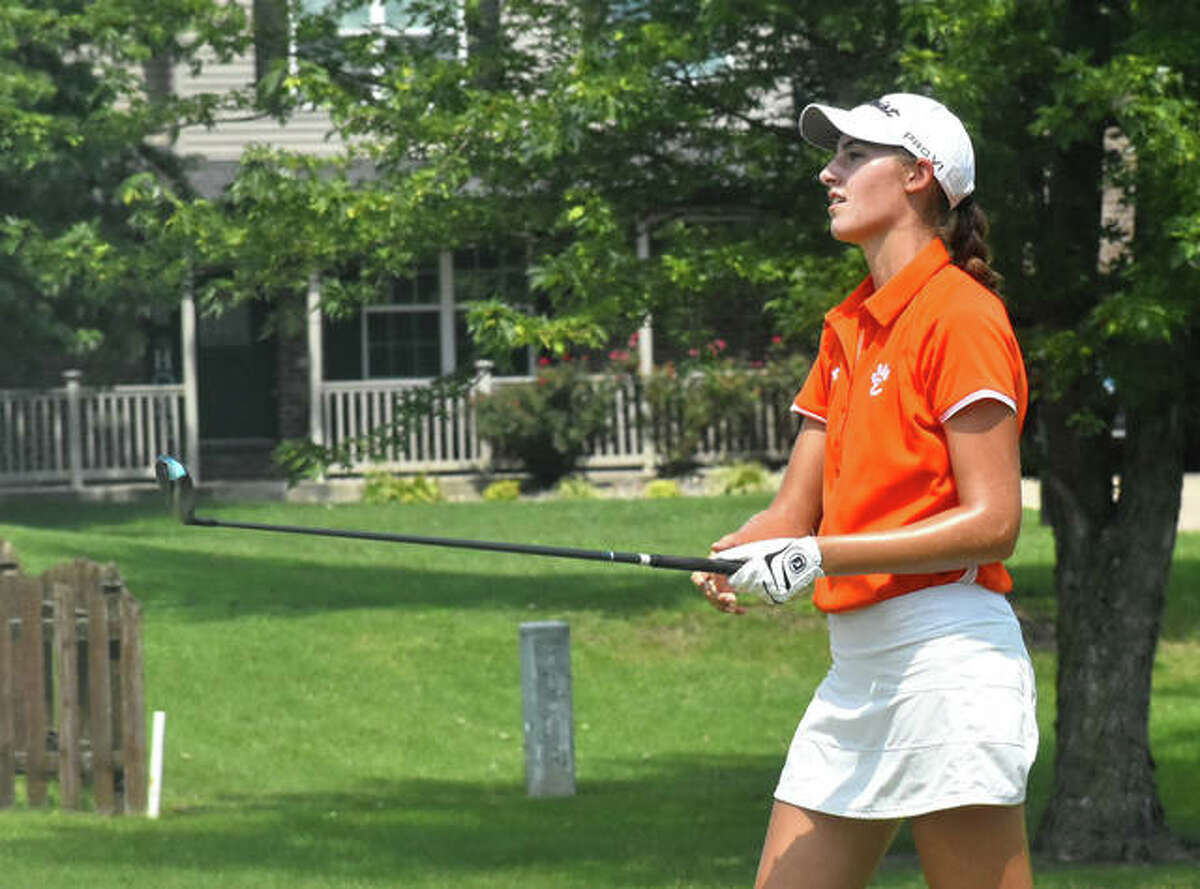 Edwardsville junior Nicole Johnson watches her tee shot on No. 3 at Legacy Golf Course during the Madison County Tournament on Tuesday in Granite City.