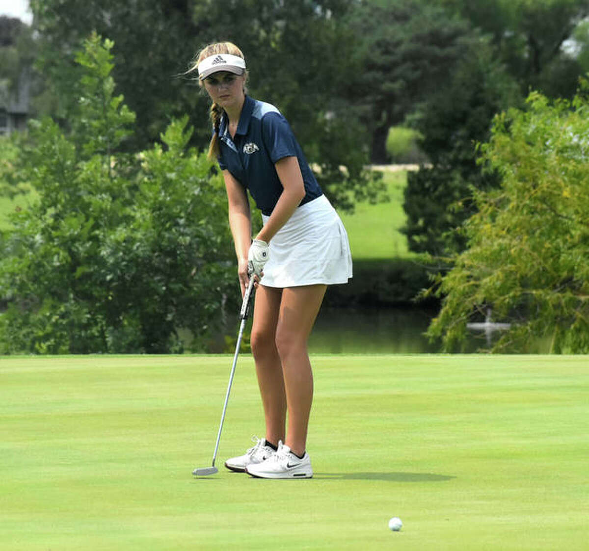 Father McGivney senior Ellie Hyten rolls a putt on No. 3 at Legacy Golf Course during the Madison County Tournament on Tuesday in Granite City.