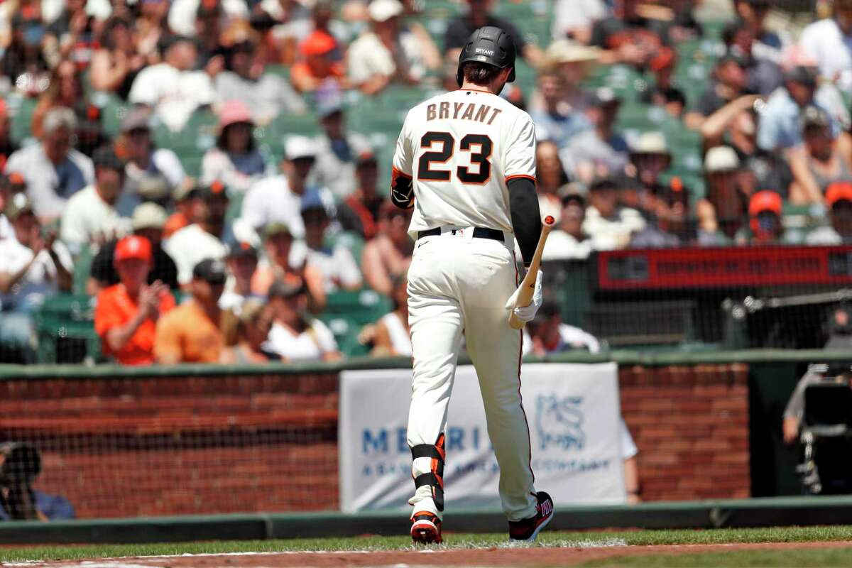 San Francisco Giants' Kris Bryant walks back to the dugout after striking out in first at bat in 1st inning against Houston Astros during MLB game at Oracle Park in San Francisco, Calif., on Sunday, August 1, 2021.