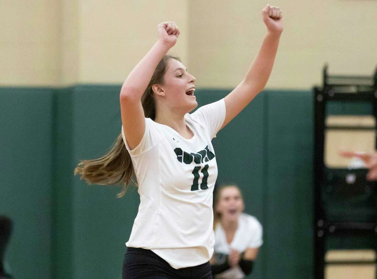 John Cooper Lauren Wolford (11) reacts after they score during the first set of a non-district volleyball game against Northland Christian at John Cooper High School, Tuesday, Aug. 17, 2021, in The Woodlands.