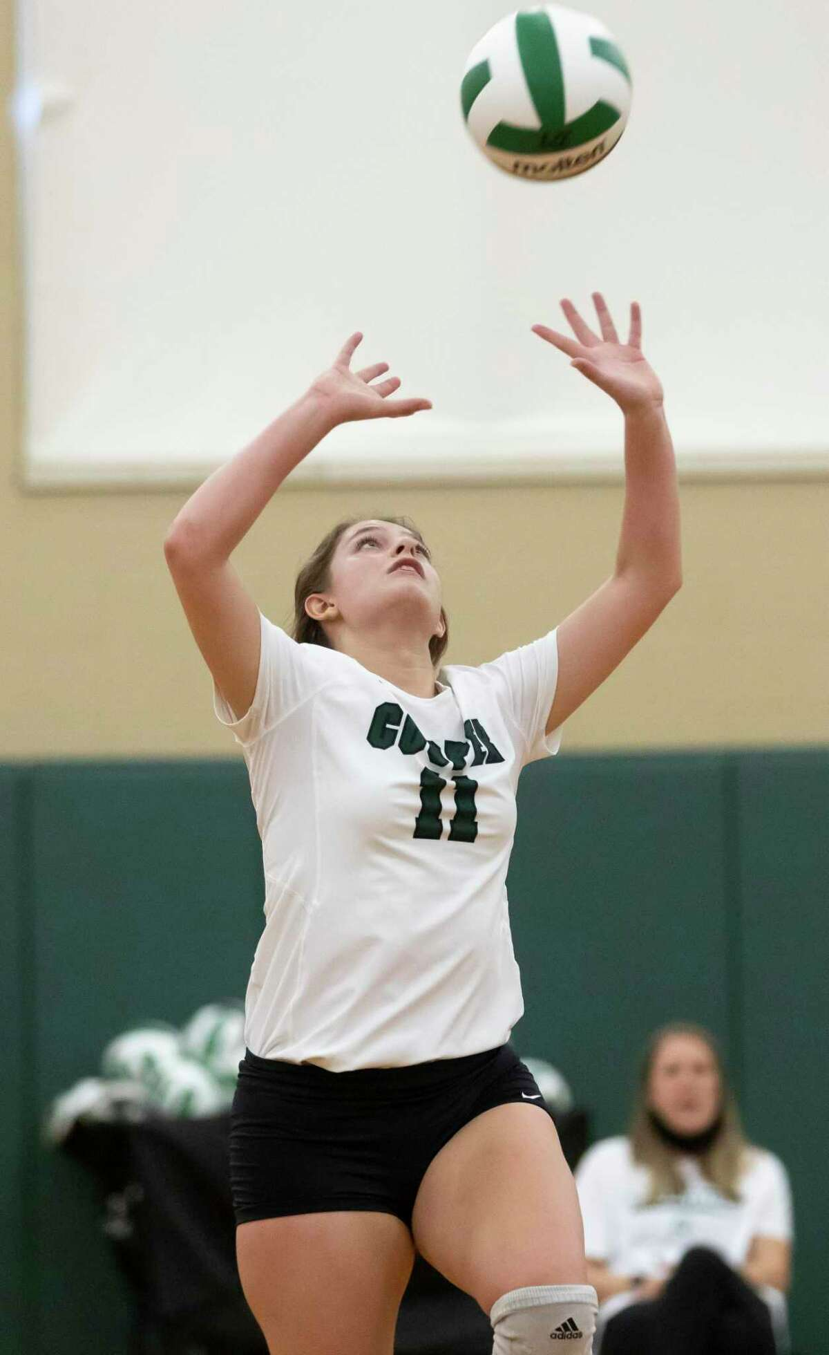 John Cooper Lauren Wolford (11) sets the ball for a play during the first set of a non-district volleyball game against Northland Christian at John Cooper High School, Tuesday, Aug. 17, 2021, in The Woodlands.