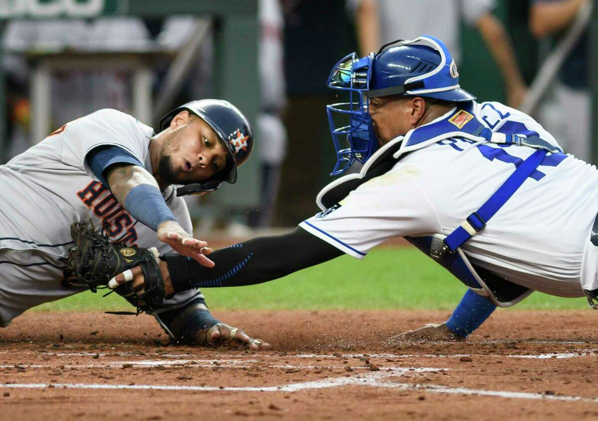 The Astros' Martin Maldonado is tagged out at home by Royals catcher Salvador Perez during the third inning as he tried to give Houston a 2-0 lead Tuesday night in Kansas City.