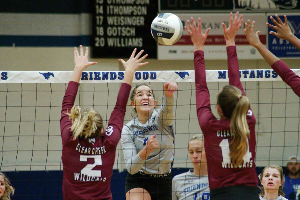 Friendswood's Meghan Donoughue (9) tries to split the defense of Clear Creek's Olivia Jones (2) and Reaghan Thompson (14) Tuesday at Friendswood High School.