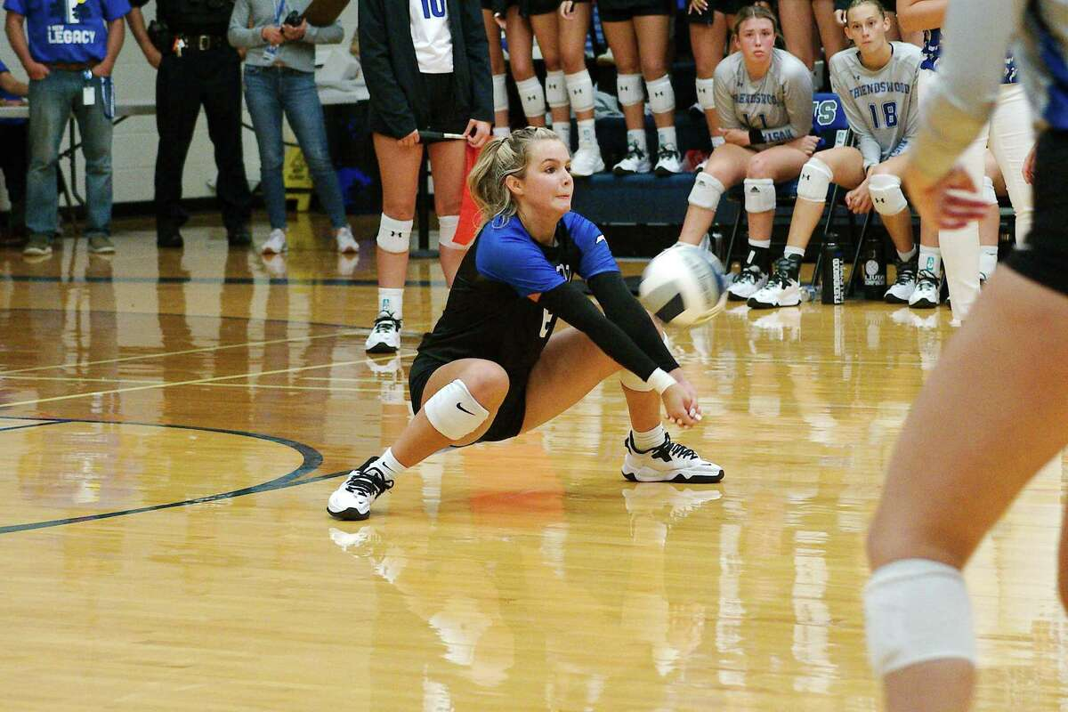 Friendswood's Andi Vaught (6) goes low for a dig against Clear Creek Tuesday at Friendswood High School.