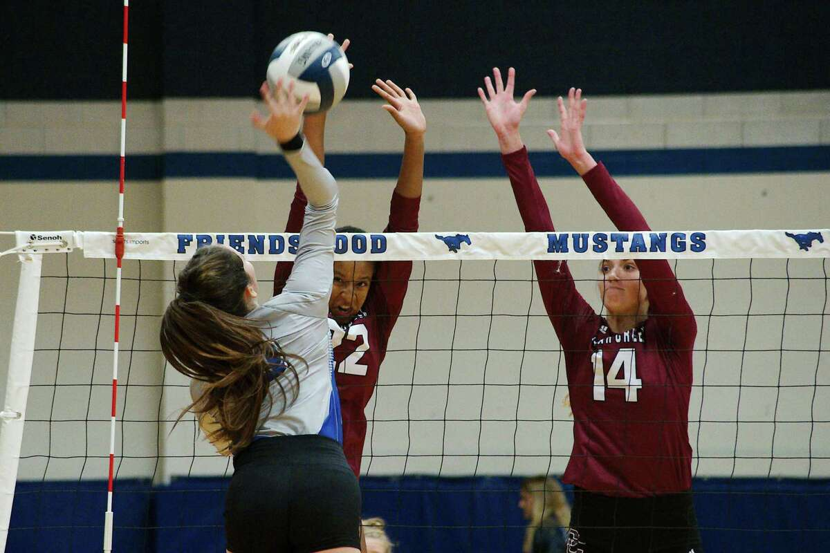 Clear Creek's Bella Woodard (22) and Reaghan Thompson (14) were instrumental Tuesday in the Lady Wildcats' five-set win over Clear Springs.