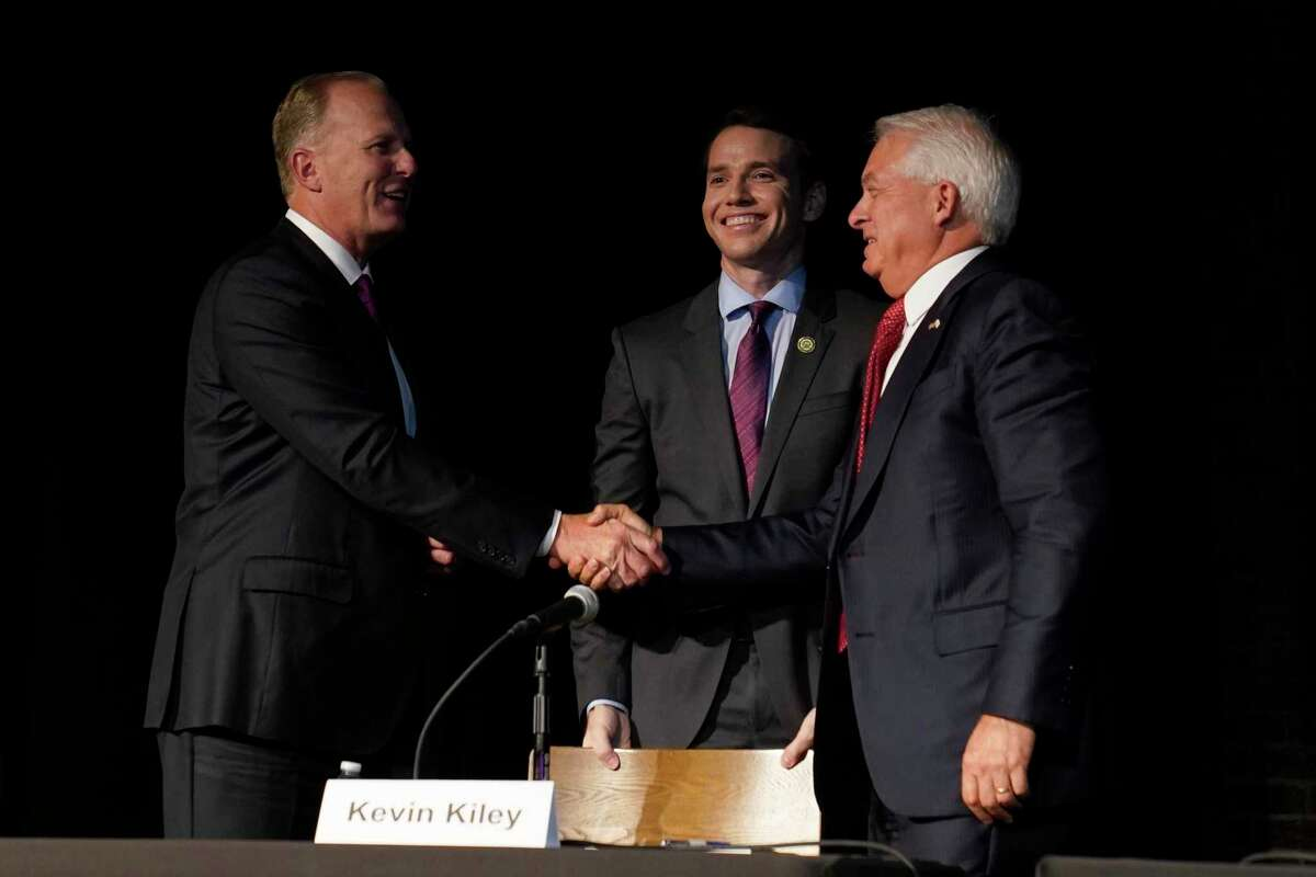 Republican gubernatorial recall candidates, former San Diego Mayor Kevin Faulconer, left, Assemblyman Kevin Kiley, center and businessman John Cox, right, gather together after their debate held by the Sacramento Press Club in Sacramento, Calif., Tuesday, Aug. 17, 2021. California voters have until Sept. 14 to cast their ballots to either retain Democratic Gov. Gavin Newsom or to recall him and select one of the more than 40 choices on the ballot. (AP Photo/Rich Pedroncelli)