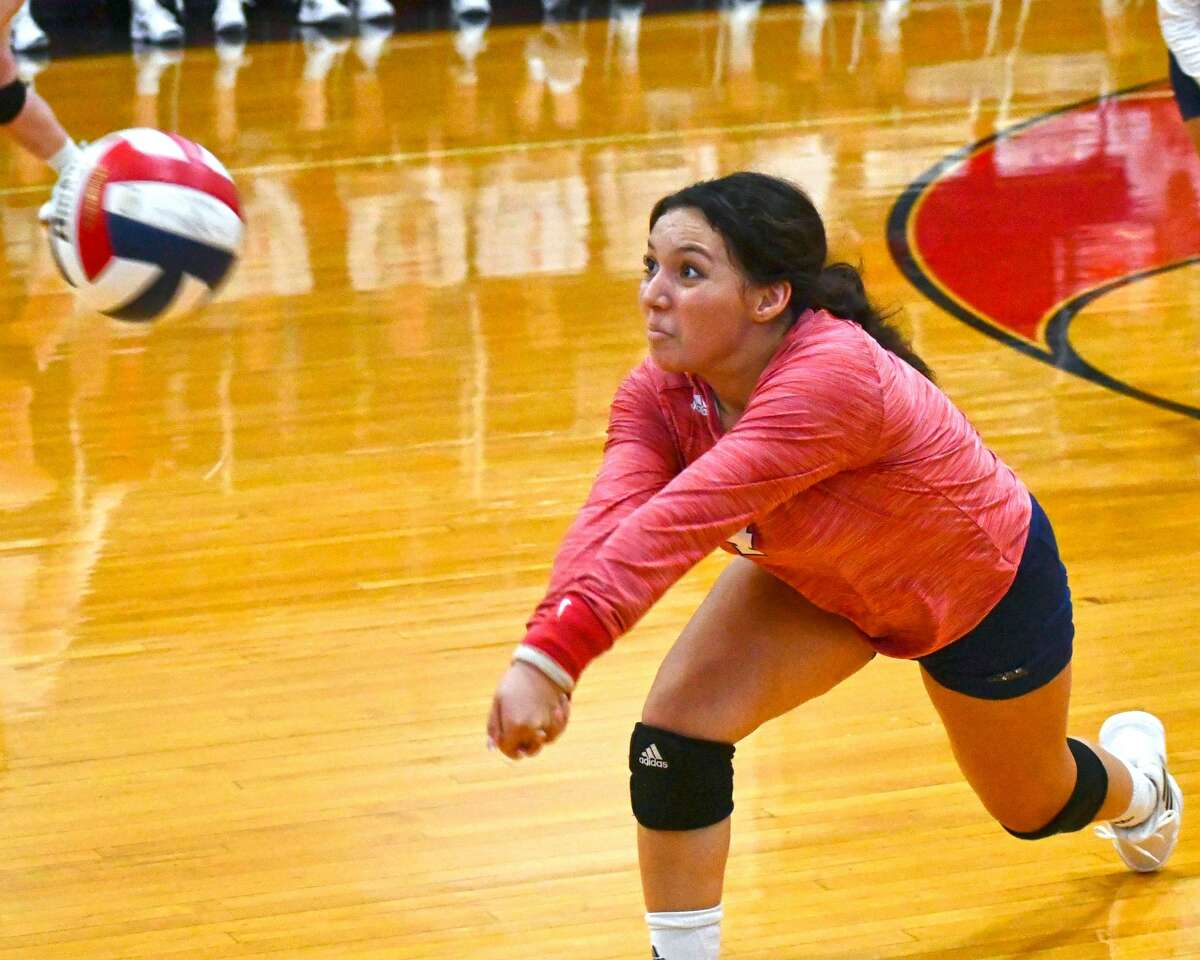 Plainview libero Haley Alderete dives to keep the ball alive during a non-district volleyball match against Wichita Falls on Tuesday in the Dog House.