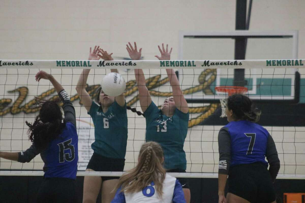 Bianca Burnett and Kaely Richardson show some defense at the net with this block Tuesday night.