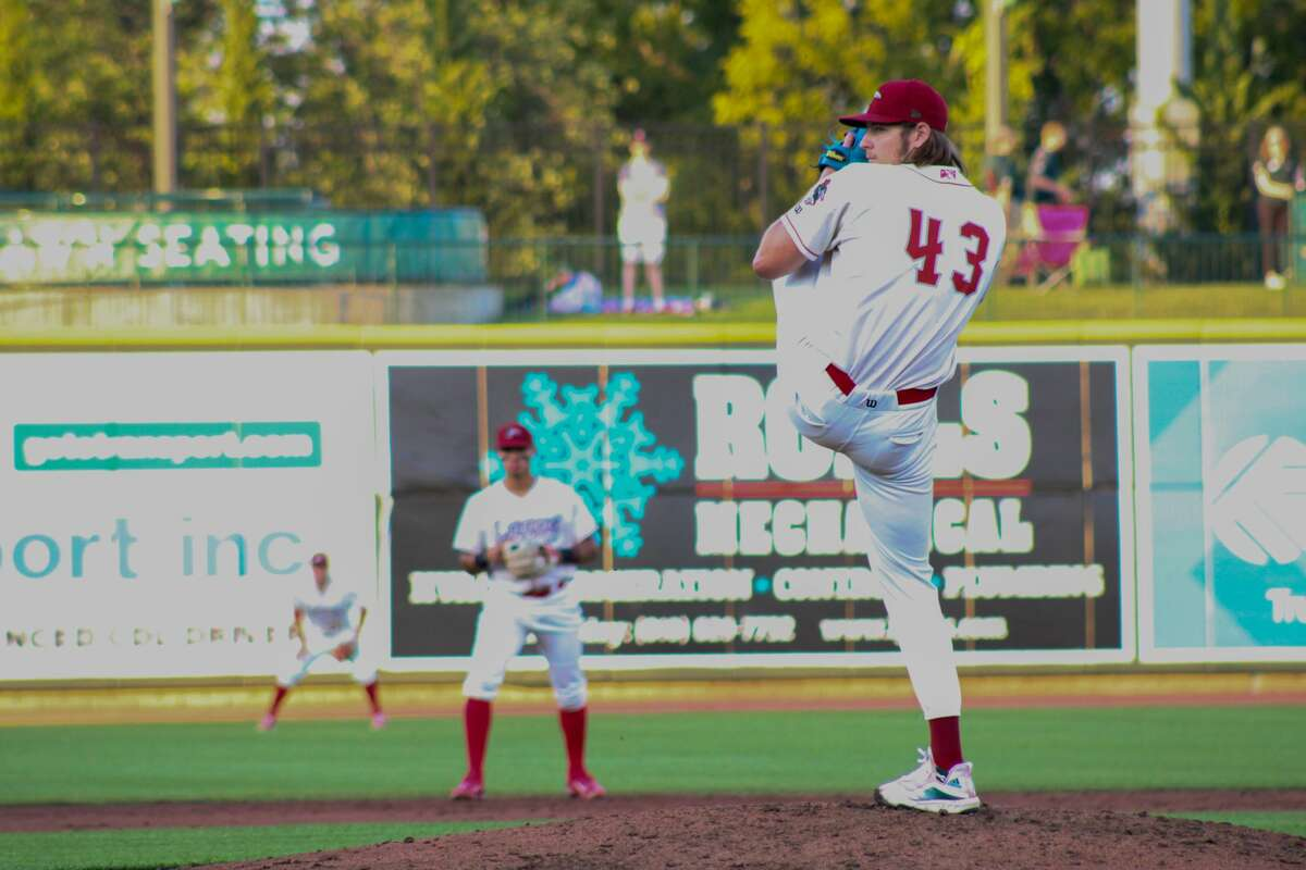 Loons pitcher Cole Percival throws a pitch against Lansing on Aug. 17 at Dow Diamond (Austin Chastain/austin.chastain@hearstnp.com)