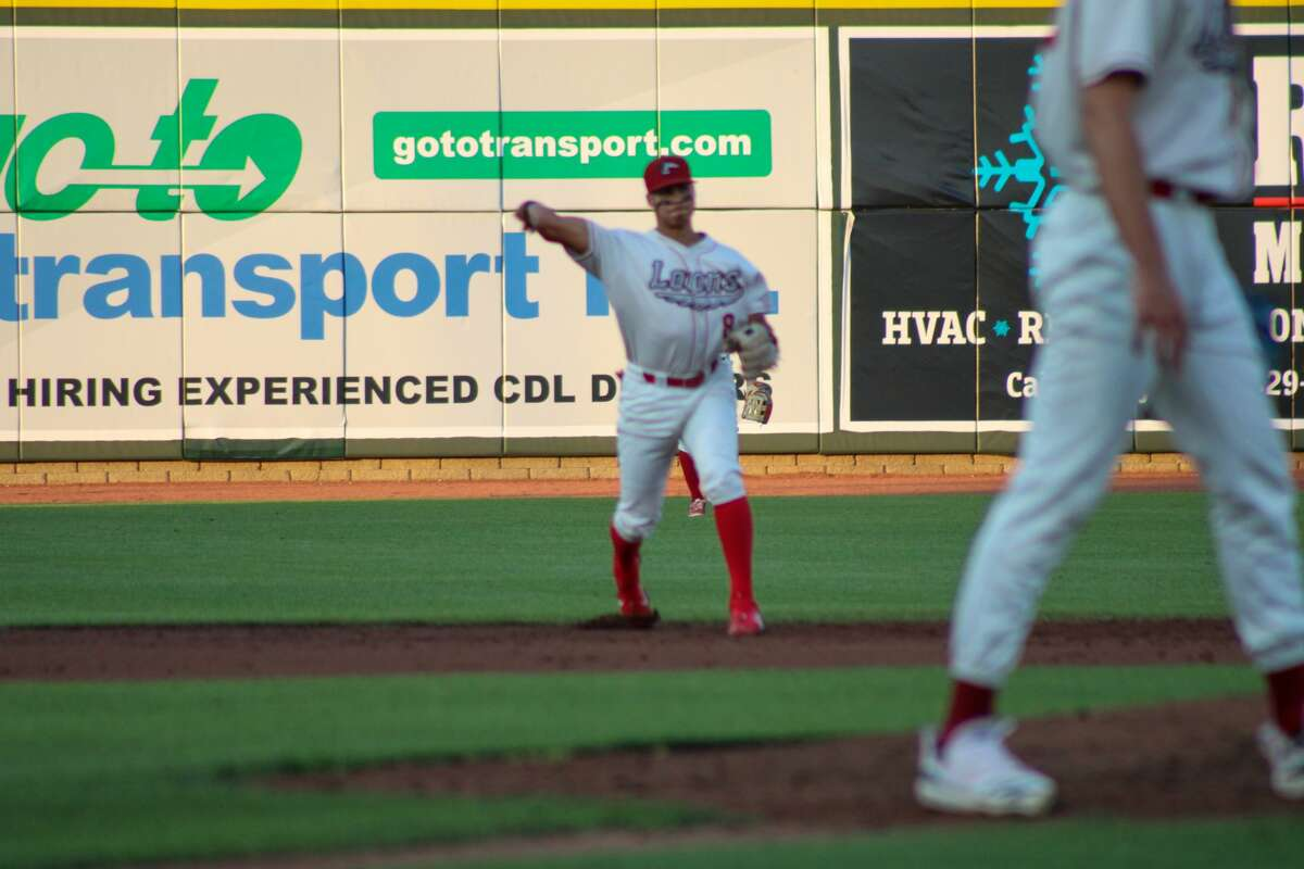 Loons shortstop Leonel Valera throws out a Lansing runner on Aug. 17 at Dow Diamond(Austin Chastain/austin.chastain@hearstnp.com)