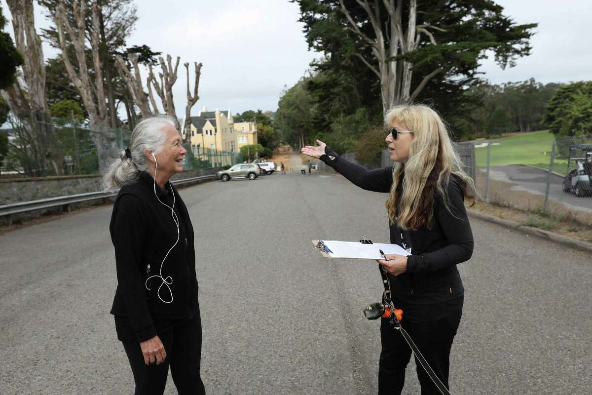 Stephanie Lehman (right), volunteer petition circulator, talks with Sandra Bayer of San Francisco after Bayer signed a petition to recall Chesa Boudin.