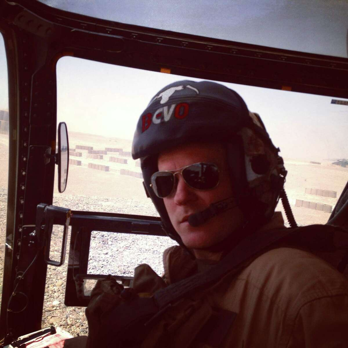 Justin Pitcock is shown in the cockpit of a V-22 Osprey in Helmand Province in 2013.