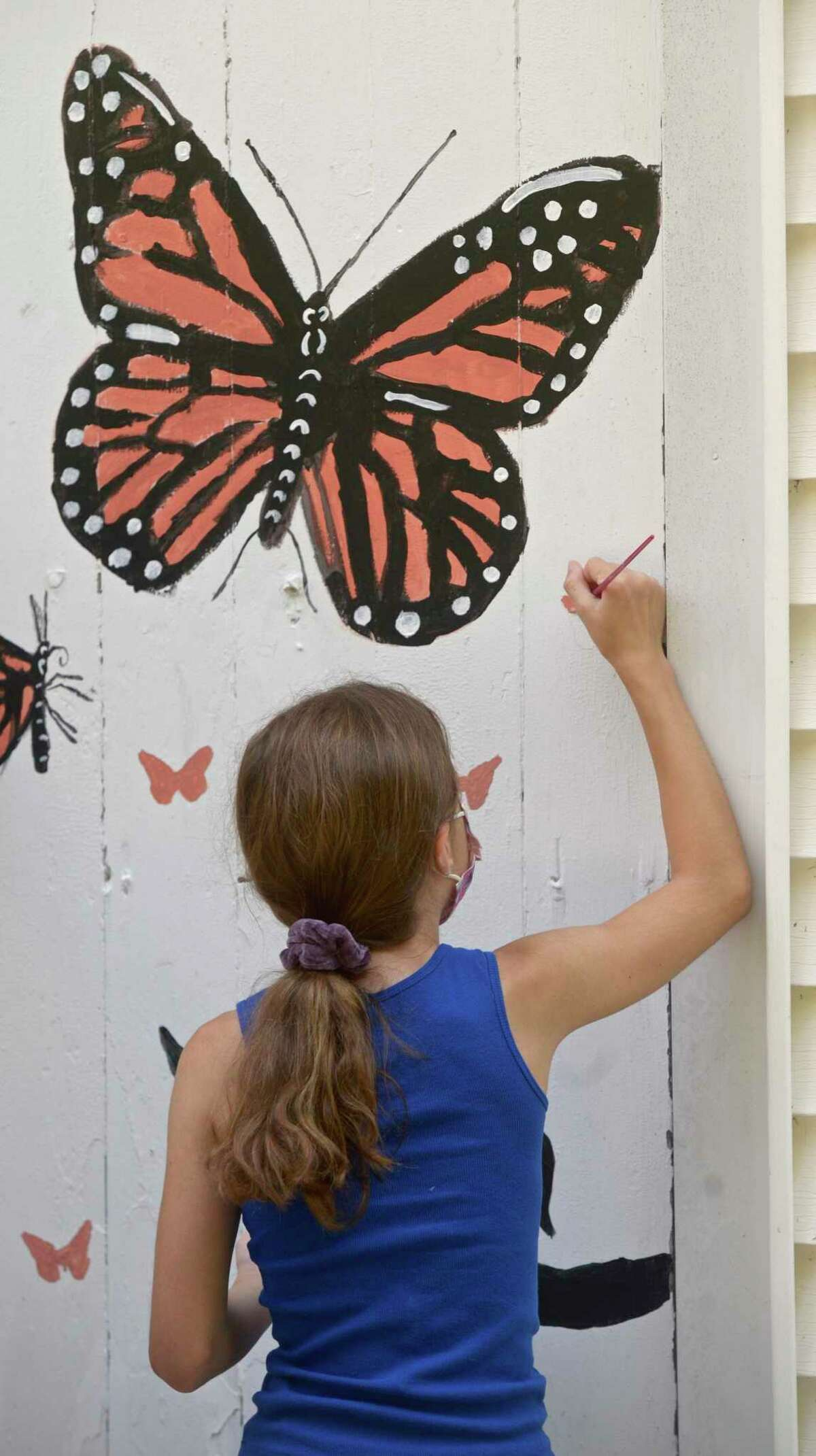 Students in the Ridgefield Guild of Artists' Summer Arts Program studied species of pollinators that live in the gardens in front the guild and have created murals on the inside and outside of the building. Friday, August 13, 2021; Ridgefield, Conn.
