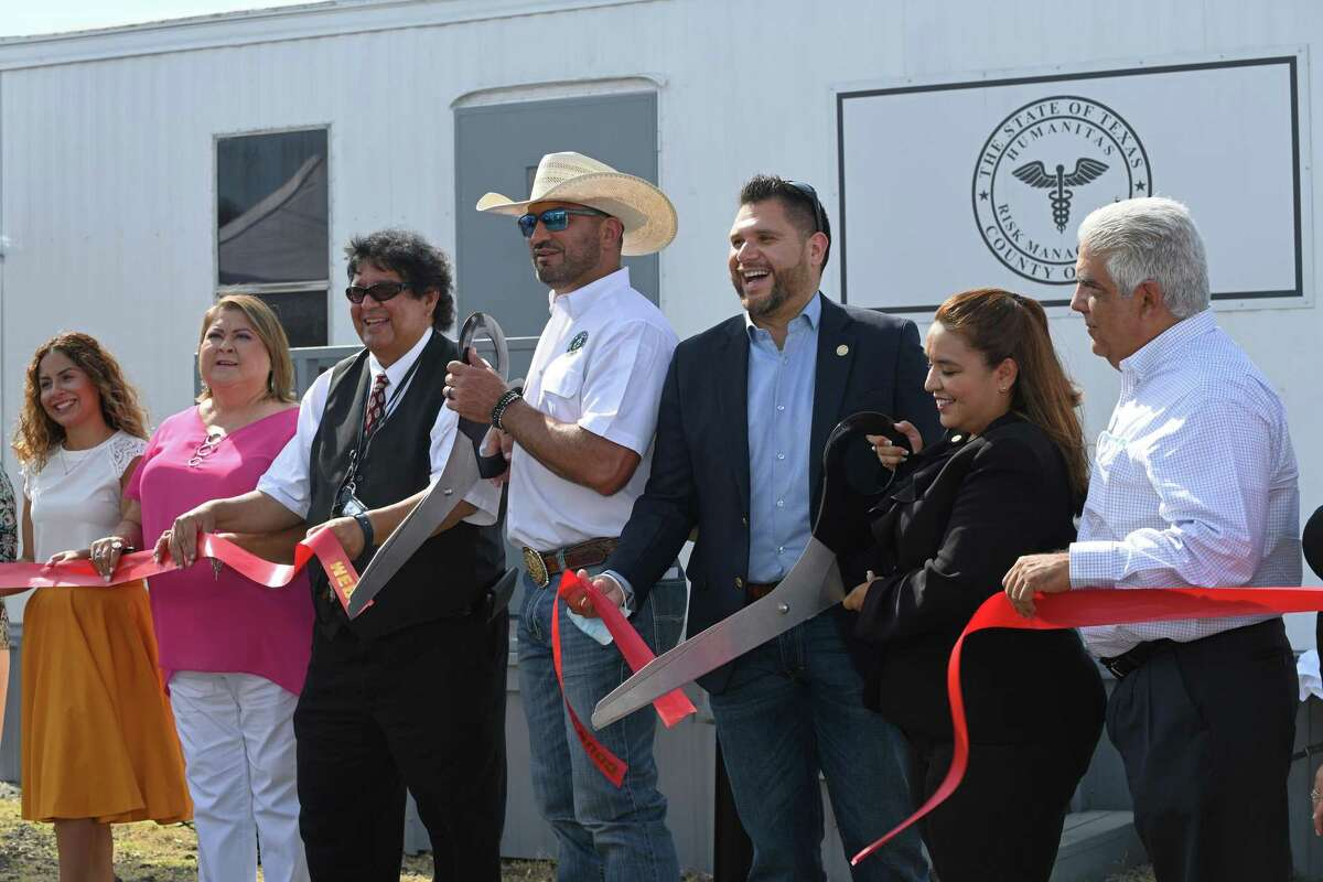 Dr. Pedro Alfaro and the Webb County Commissioners court cut the ribbon in celebration Tuesday of the grand opening of the Webb County Employee Medical and Wellness Center.
