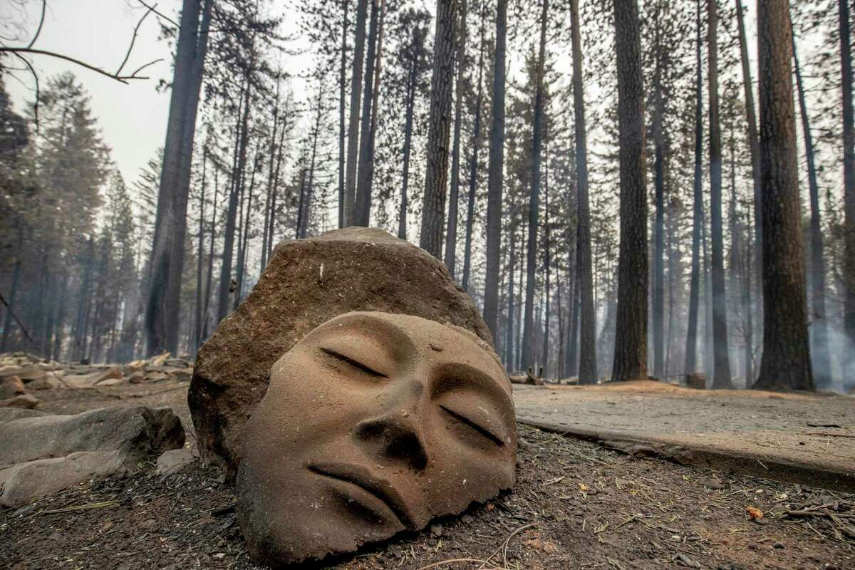 A sculpture rests in front of a Grizzly Flats home destroyed by the Caldor Fire in El Dorado County, Calif.