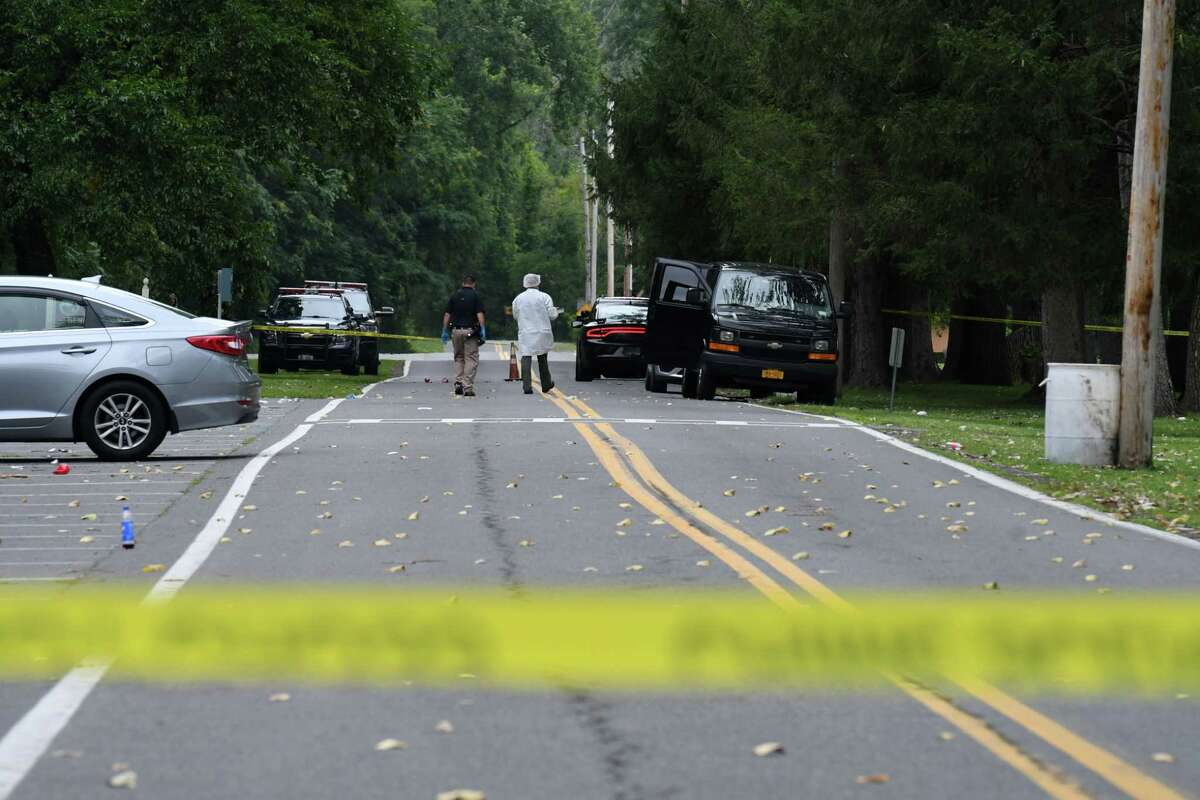 Police investigate a fatal overnight shooting at Henry Hudson Park on Wednesday, Aug. 18, 2021, in Bethlehem, N.Y. Another person suffered non-life-threatening injuries.