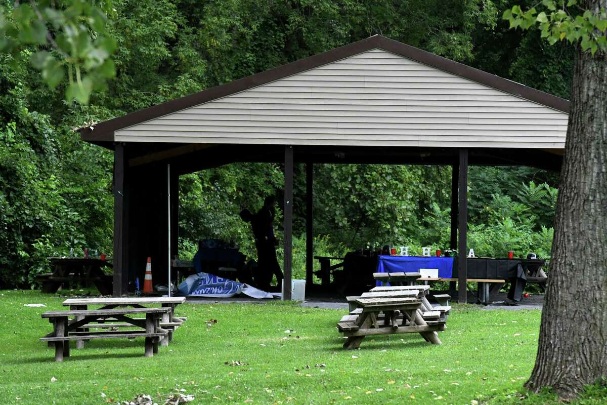 Leftovers from a party at Henry Hudson Park are visible where police are investigating a fatal overnight shooting on Wednesday, Aug. 18, 2021, in Bethlehem, N.Y. Another person suffered non-life-threatening injuries.