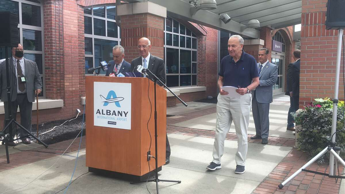 Senator Charles Schumer arrives at Albany International Airport to tout $29 million in potential improvements that would be made with the passage of the federal governments $1 trillion infrastructure plan. Capital District Transportation Authority Executive Director Carm Basile, left, and airport Chief Executive Officer Phile Calderone, right stand at the podium.