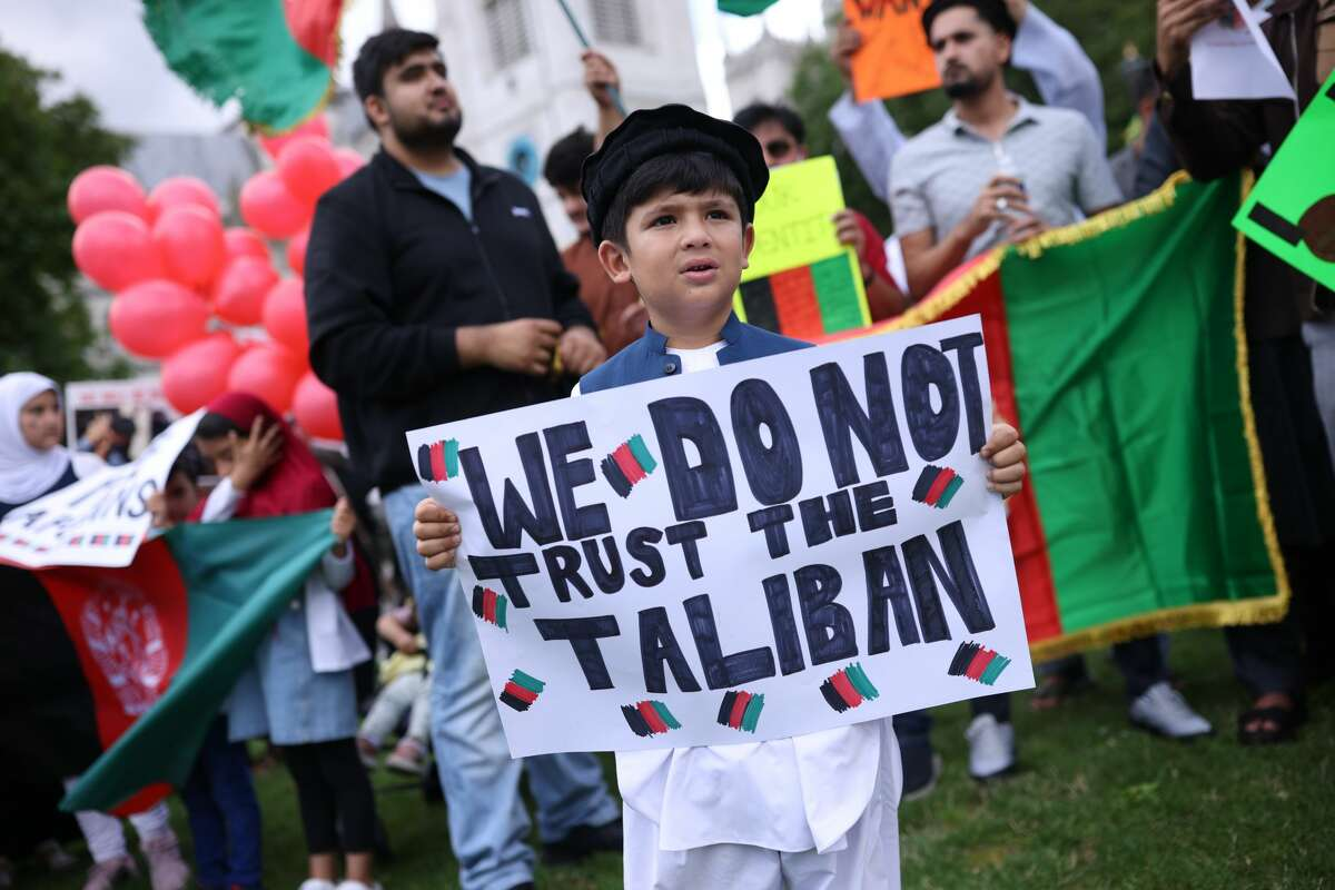 Protesters gather on Parliament Square to protest against the Taliban take over of Afghanistan on Aug. 18, 2021 in London, United Kingdom. (Photo by Dan Kitwood/Getty Images)