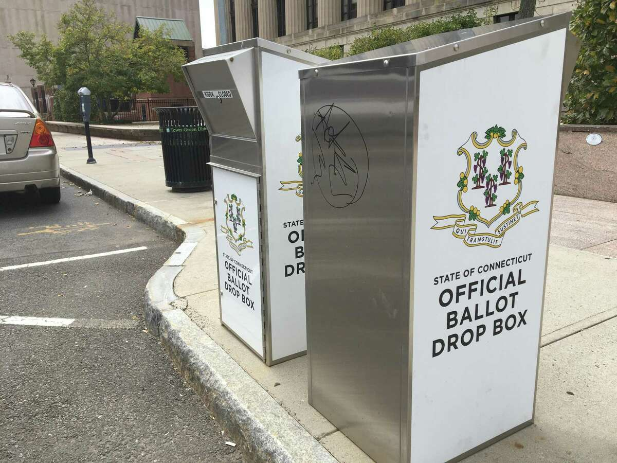 An absentee ballot dropbox in New Haven opposite the front entrance of the Hall of Records, 200 Orange St.