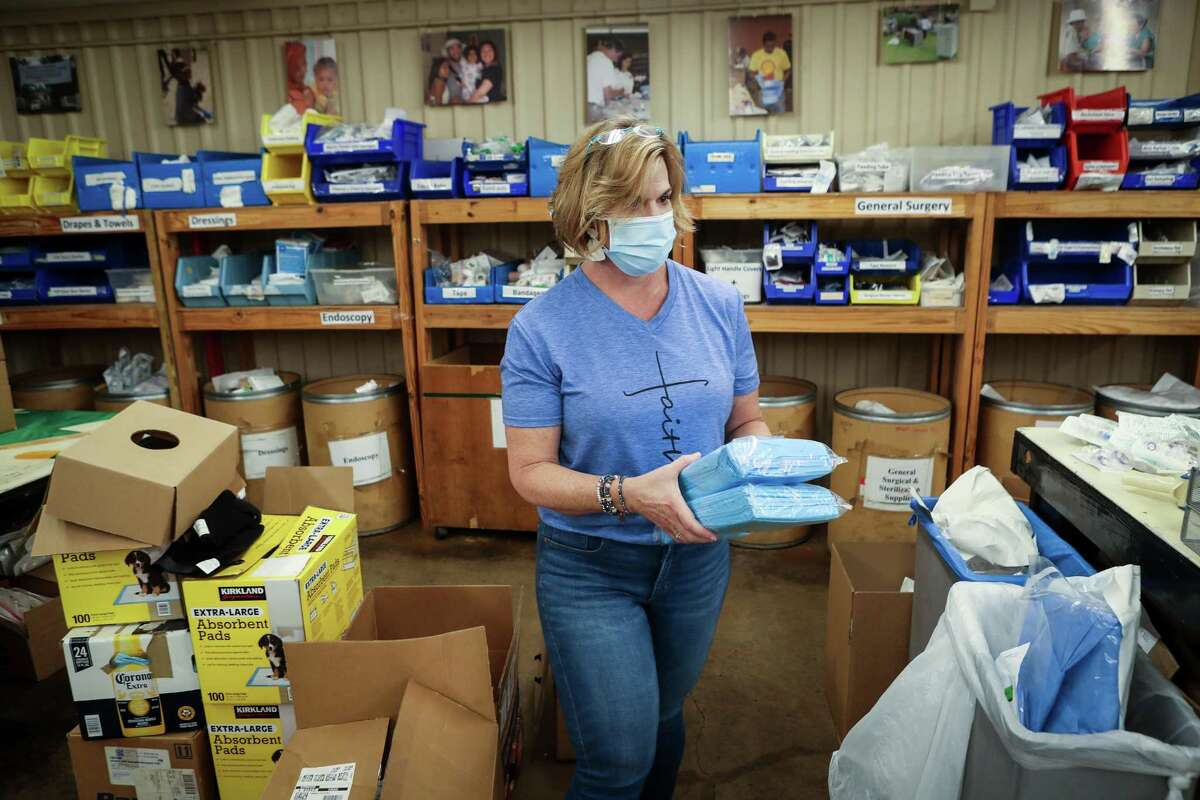 Volunteer Debbie Ayers sorts medical supplies at Medical Bridges Tuesday, Aug. 17, 2021 in Houston. Medical Bridges will send medical supplies, along with a Texas Aggie Medical Clinic to Haiti to help with earthquake and tropical storm relief.