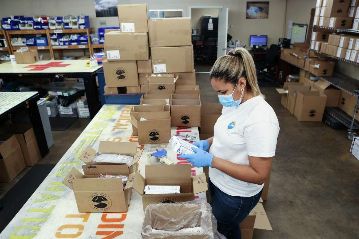 Wendy Socarras sorts medical supplies at Medical Bridges Tuesday, Aug. 17, 2021 in Houston. Medical Bridges will send medical supplies, along with a Texas Aggie Medical Clinic to Haiti to help with earthquake and tropical storm relief.