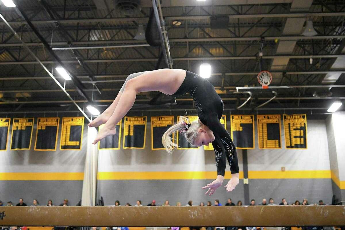 Farmington's Anna Mihalek competes in the Balance Beam during the CIAC Class M Gymnastics Championship at Jonathan Law, Saturday, February 29, 2020,