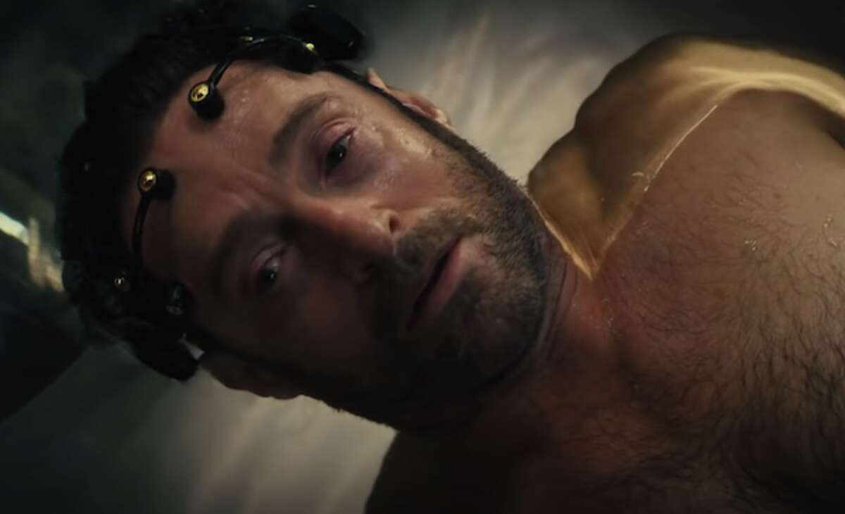 """""""It's great that this can help me relive memories, but can it erase them, too? Like appearing in 'Movie 43'? Or hearing Russell Crowe singing in 'Les Miserables'?"""" This is only our guess as to the Method acting tricks Hugh Jackman might have utilized while making his new sci-fi mystery, """"Reminiscence."""""""