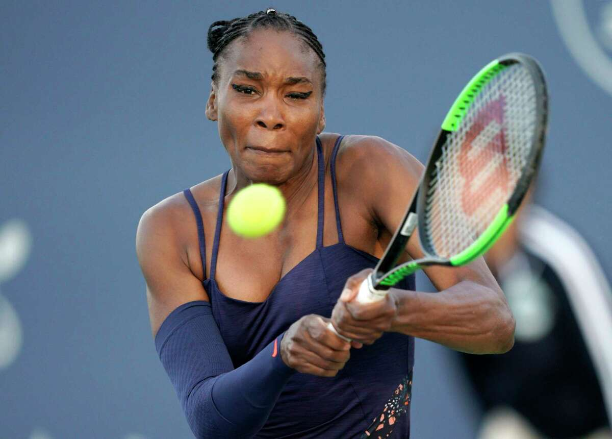 Venus Williams, of the United States, hits a backhand to Bethanie Mattek-Sands, of the United States, during the Mubadala Silicon Valley Classic tennis tournament in San Jose, Calif., Tuesday, July 30, 2019. (AP Photo/Tony Avelar)