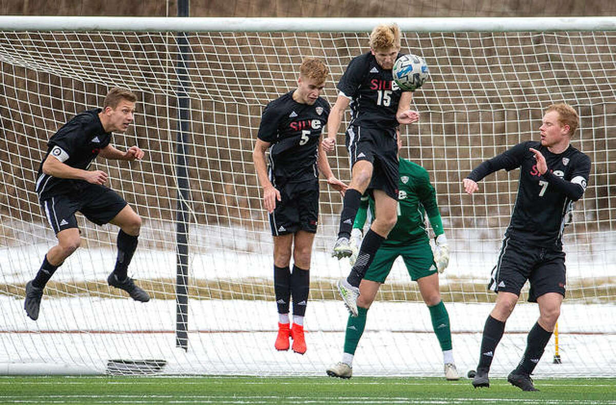 During the 2020 season, which began in February of this year because of the pandemic, the SIUE defense makes a stand and Jack Edwards (15) heads the ball away from the Cougars' goal against the University of Evansville in a game played with mounds of plowed snow surrounding Bob Guellker Field at Korte Stadium.