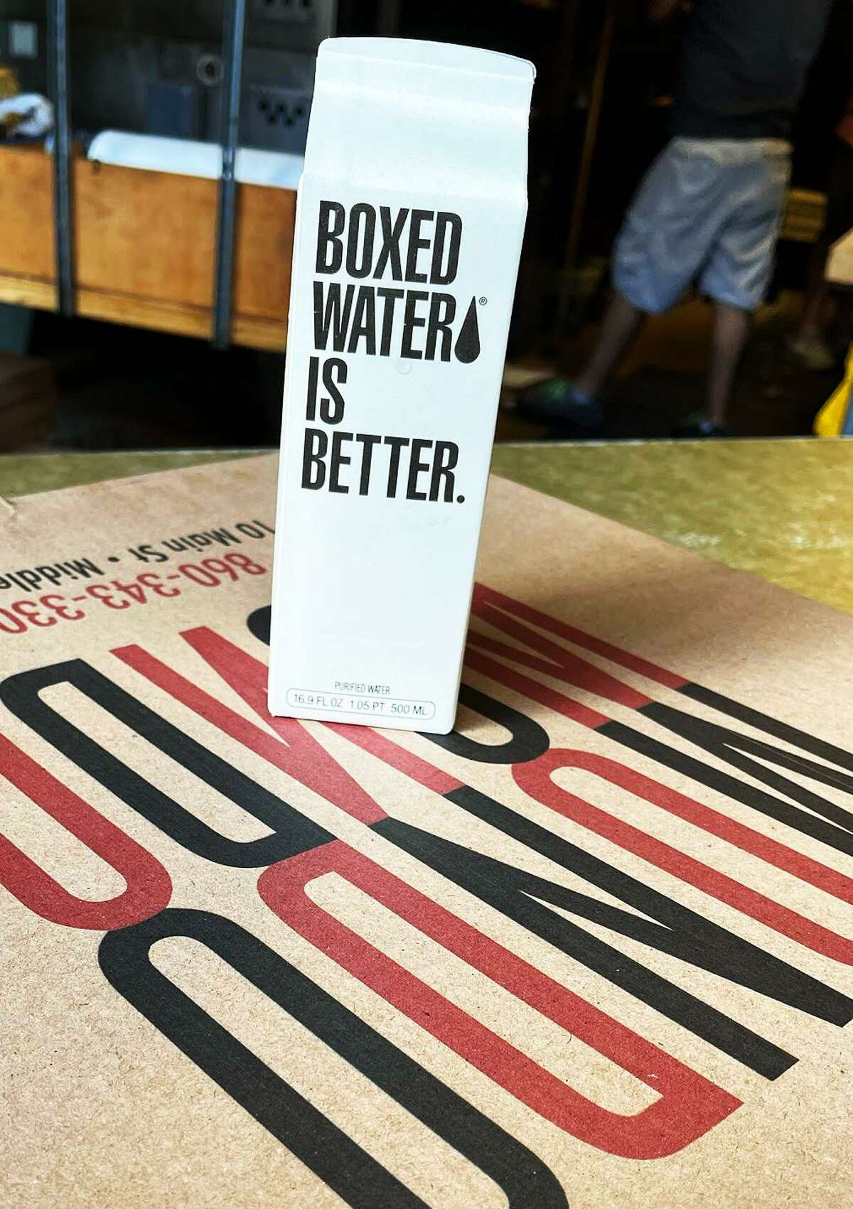 Mondo Pizza, on Main Street in Middletown, has replaced single-use plastic water bottles with water in cartons.