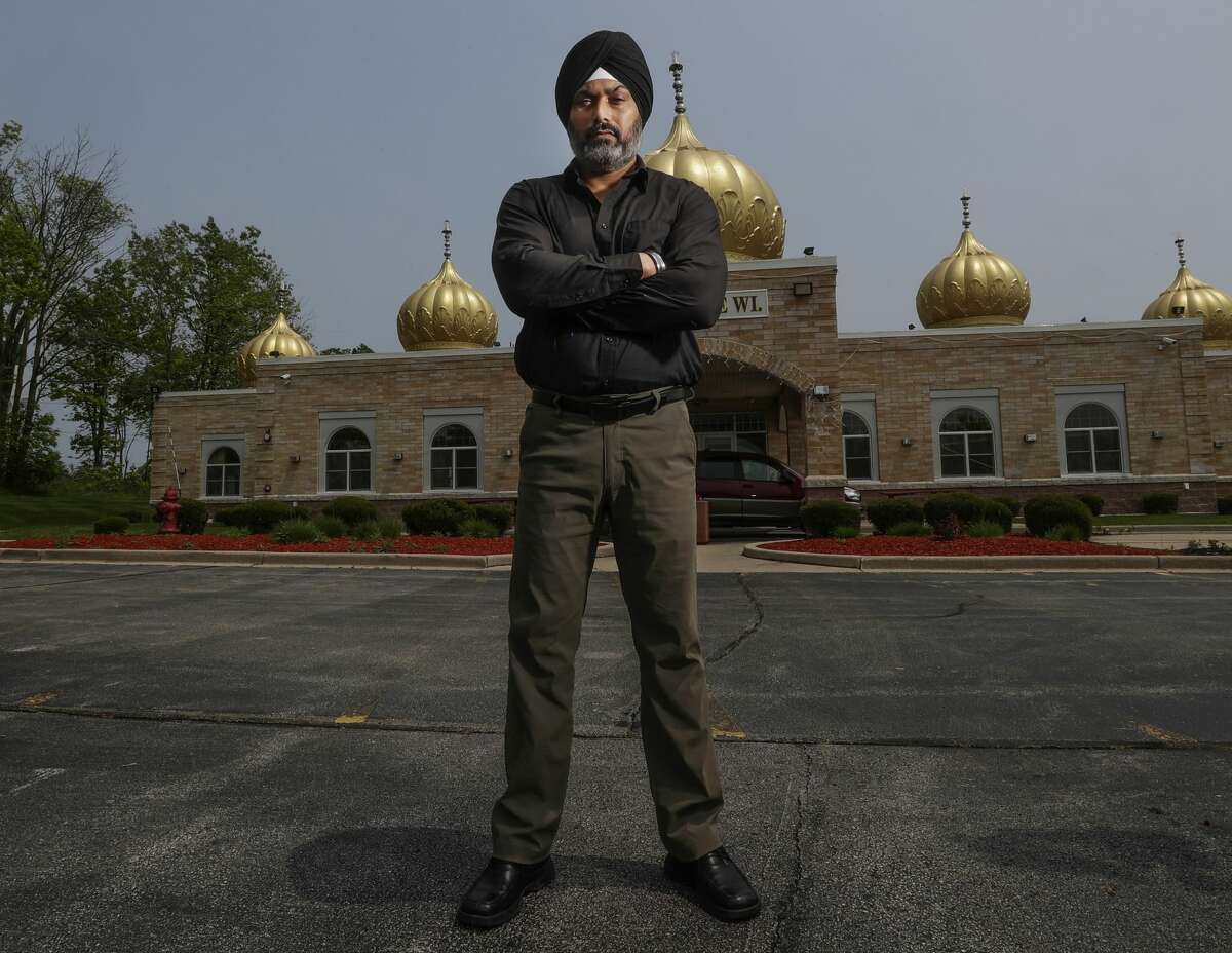 In this Saturday, June 1, 2019 photo, Pardeep Singh Kaleka stands outside the Sikh Temple in Oak Creek, Wis. where Kaleka's father was one of six worshippers murdered in a 2012 mass shooting.