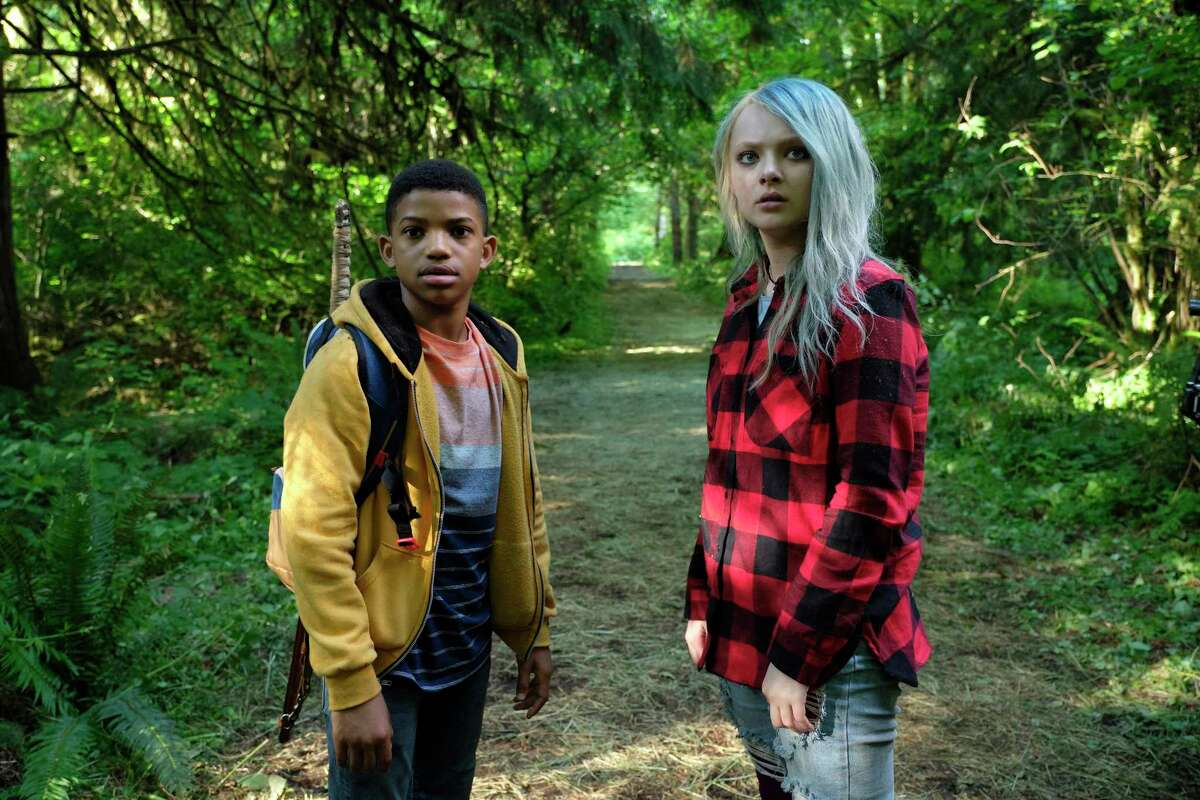 """Gunner (Lonnie Chavis) and his friend Jo (Amiah Miller) head out into the woods in """"The Water Man."""""""