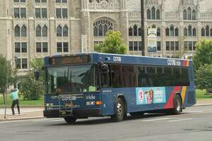 A CDTA bus is seen turning onto State St. from Broadway on Wednesday, Aug. 18, 2021 in Albany, N.Y.