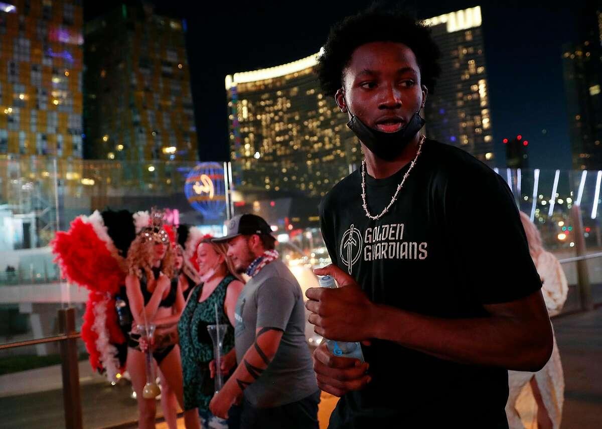 After an NBA Summer League game earlier, Jonathan Kuminga of the Golden State Warriors walks on the Strip in Las Vegas.