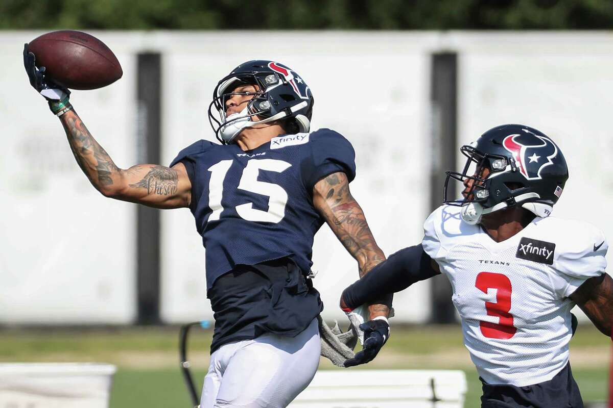 Houston Texans wide receiver Chris Moore (15) makes a one-handed catch against defensive back Cornell Armstrong (3) during an NFL training camp football practice Wednesday, Aug. 18, 2021, in Houston.