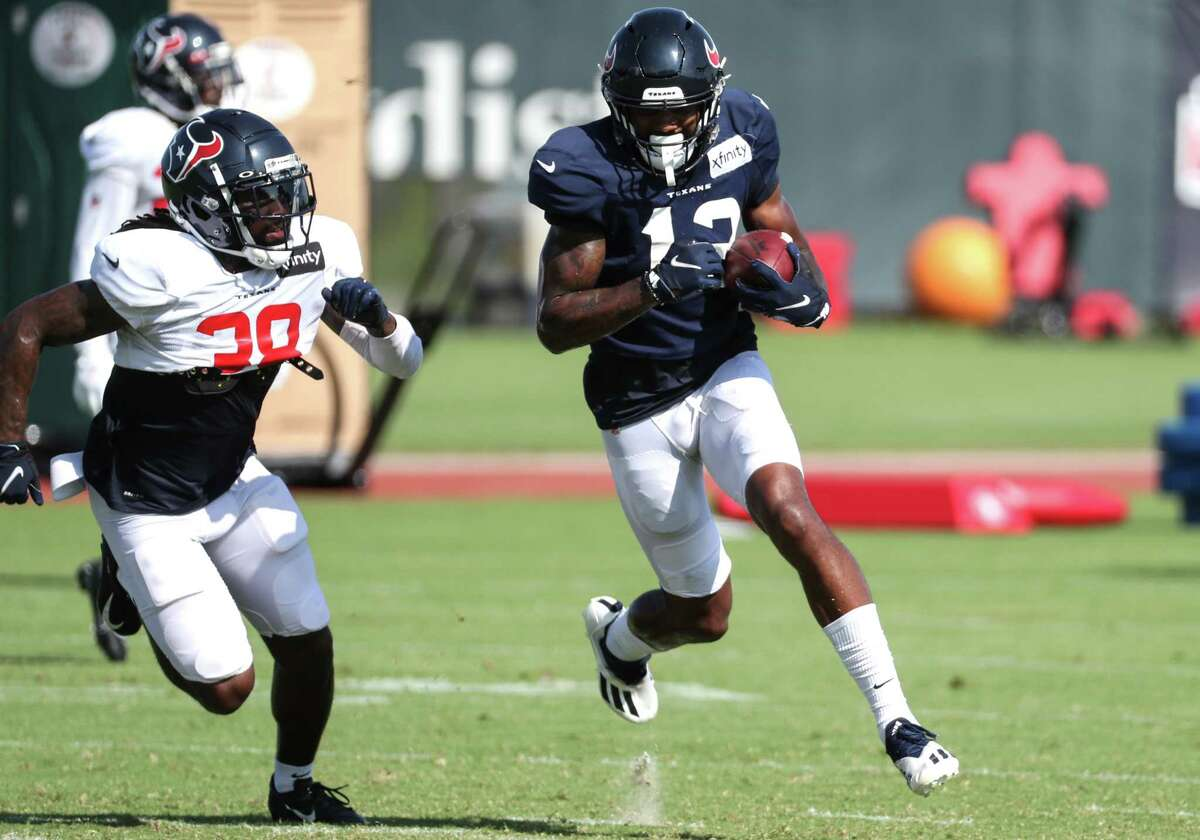 Houston Texans wide receiver Brandin Cooks (13) runs the ball after making a catch against safety Shyheim Carter (38) during an NFL training camp football practice Wednesday, Aug. 18, 2021, in Houston.