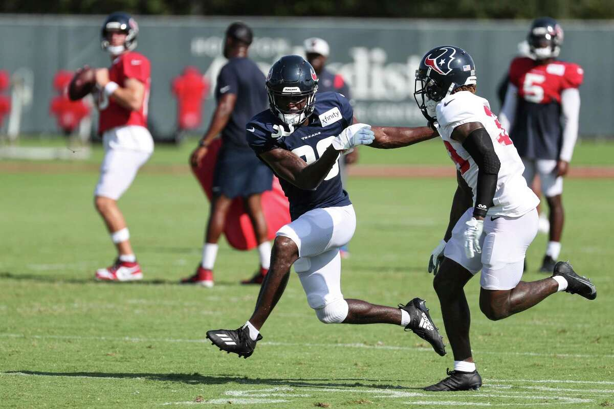 Houston Texans wide receiver Taywan Taylor (89) runs a route against cornerback Terrance Mitchell (39) during an NFL training camp football practice Wednesday, Aug. 18, 2021, in Houston.