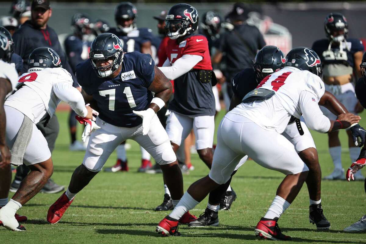 Houston Texans offensive tackle Tytus Howard (71) drops back to pass block during an NFL training camp football practice Wednesday, Aug. 18, 2021, in Houston.