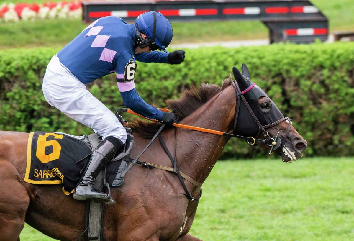 Jockey Thomas Garner is jubilant aboard The Mean Queen after winning the 80th running of the Jonathan Shepard at Saratoga Race Course on Wednesday, Aug. 18, 2021, in Saratoga Springs, N.Y.