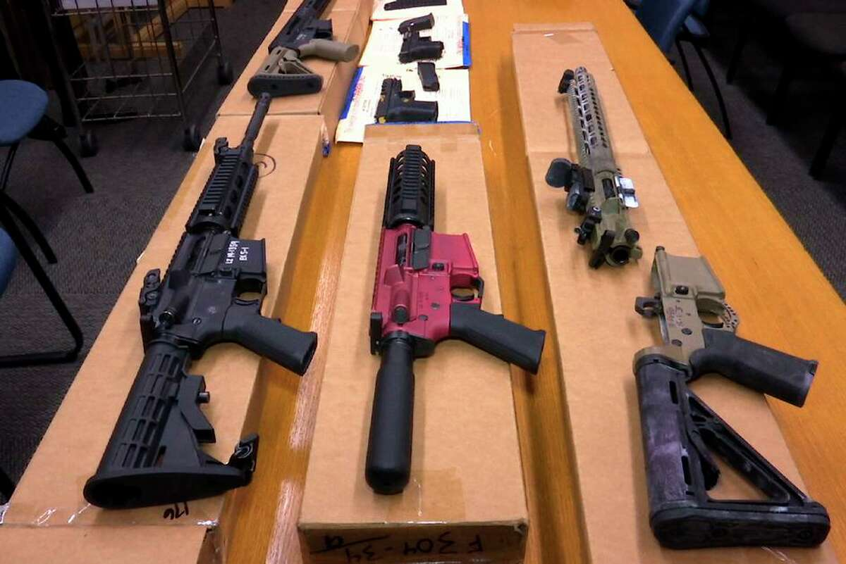 """""""Ghost guns,"""" sold in parts or kits to evade tracing, are shown at San Francisco Police Department headquarters in 2019."""