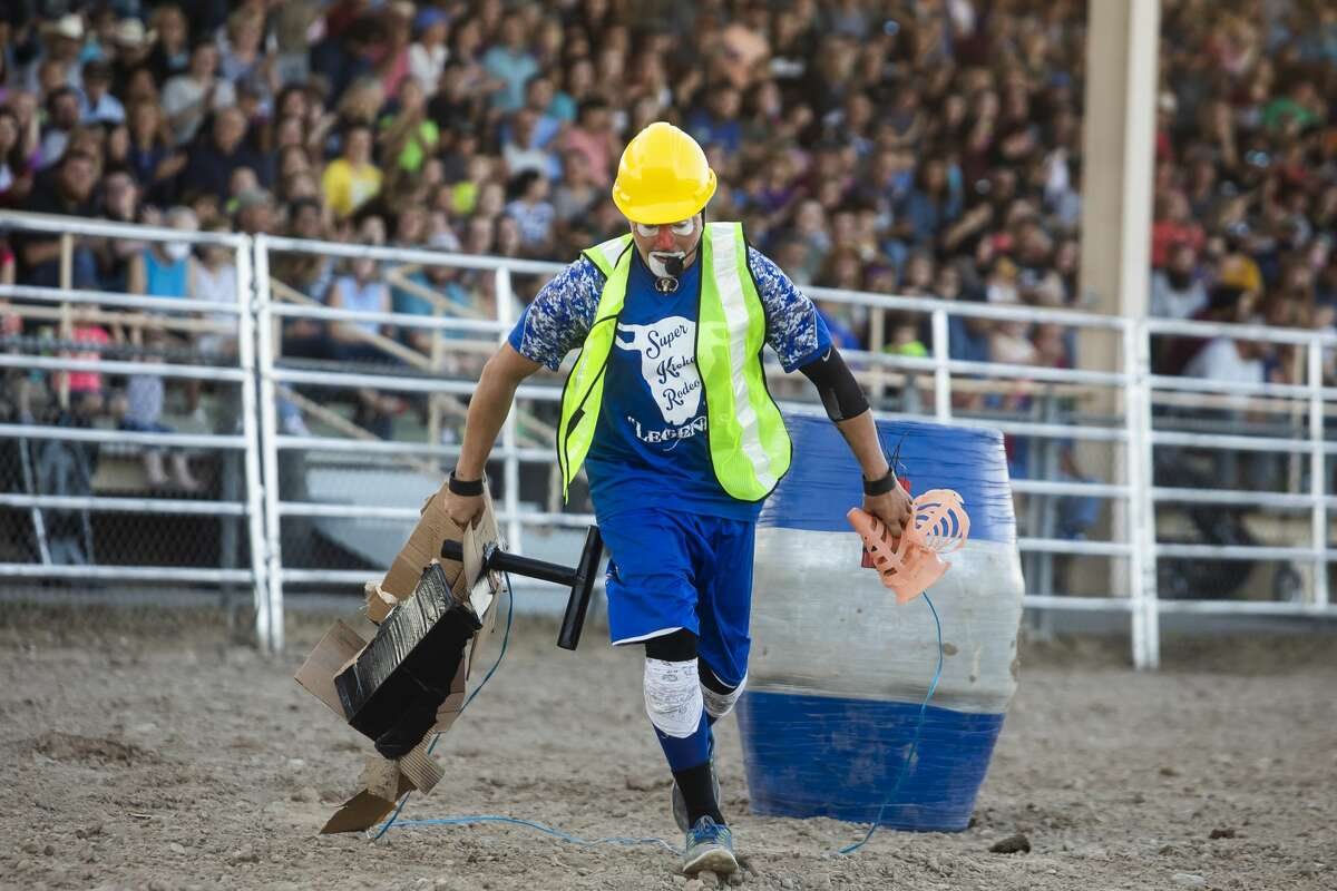Rodeo clown Christopher DeBaeke works the crowd for laughs during the first night of the Super Kicker Rodeo Monday, Aug. 16, 2021 at the Midland County Fairgrounds. (Katy Kildee/kkildee@mdn.net)