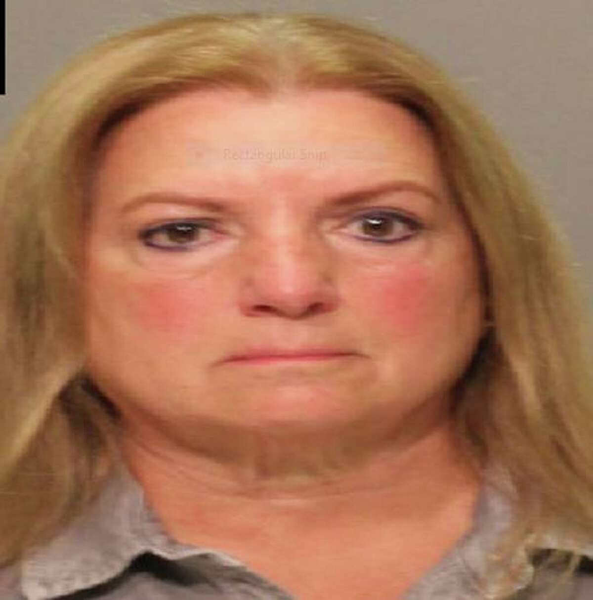 Darlene Moonan, 64, of Woodland Court, Bedford, N.Y., was arrested on charges of first-degree larceny and first-degree identity theft, according to the Greenwich Police Department.