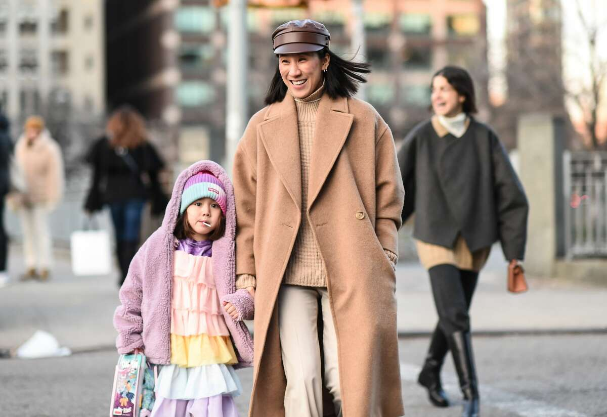 Eva Chen with daughter Ren and Leandra Medine are seen outside the Christopher John Rogers show during New York Fashion Week: A/W20 on February 08, 2020 in New York City. (Photo by Daniel Zuchnik/Getty Images)