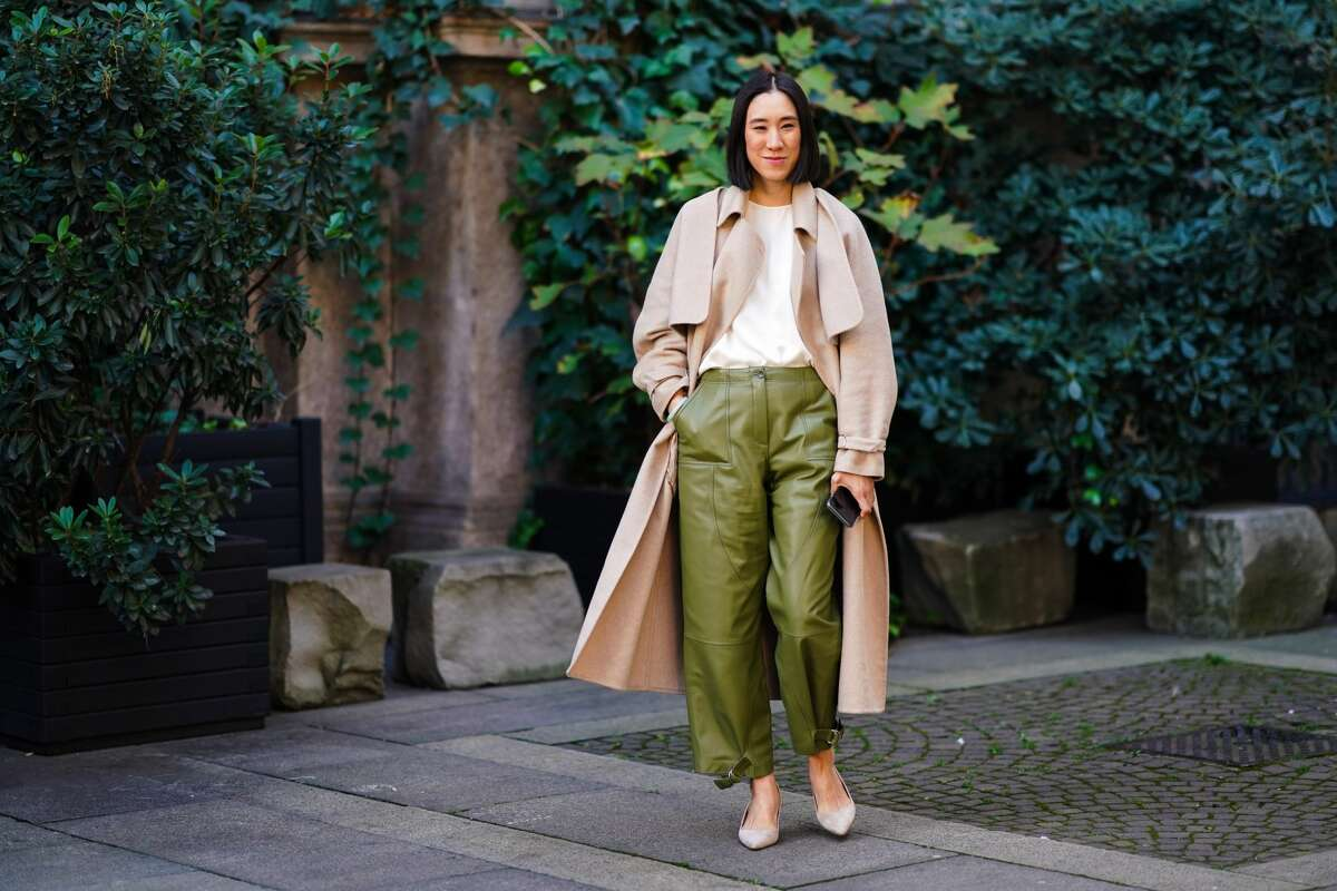Eva Chen wears a beige long coat, a white t-shirt, green leather pants, pointy shoes, outside Koche x Pucci, during Milan Fashion Week Fall/Winter 2020-2021 on February 20, 2020 in Milan, Italy. (Photo by Edward Berthelot/Getty Images)
